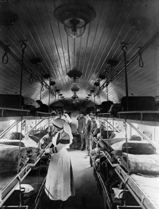 Interior of a ward on a British ambulance train showing the narrow aisle and triple bunks.  Courtesy Imperial War Museum © IWM (Q 8749)