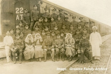 Staff Nurse Susan 'Susie' Greaves, nurse on left, with the staff of No 22 Ambulance Train, c1917-1918